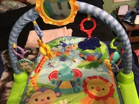 baby's white, green, and blue activity gym