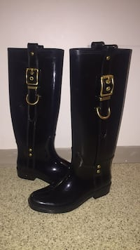 Pair of black Coach  knee-high rain boots Vancouver, V6Z 2X5