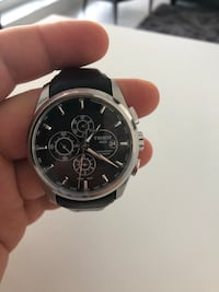 Round silver-colored chronograph watch with black leather strap 538 km