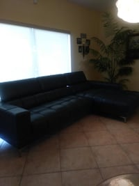 black leather sectional sofa with ottoman null