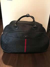 black and red Gucci duffel bag