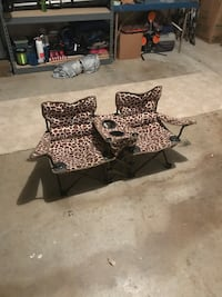 two brown-and-white giraffe camping chairs Houston, 77092