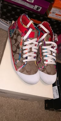 Pair of brown-and-red coach sneakers  1213 mi