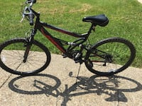 Black and red full-suspension mountain bike. Barley used $70 Orleans, 47452