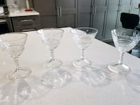 three clear glass candle holders 533 km