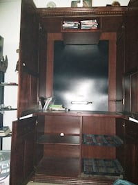 black flat screen TV with black wooden TV stand Corpus Christi, 78408