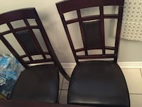 two black wooden framed black leather padded chairs Brampton, L6V 2P6