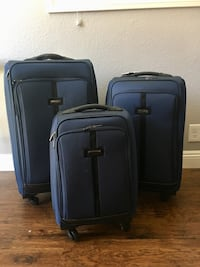 Calvin Klein 3-piece luggage set (dark blue). Lightly used and well-kept