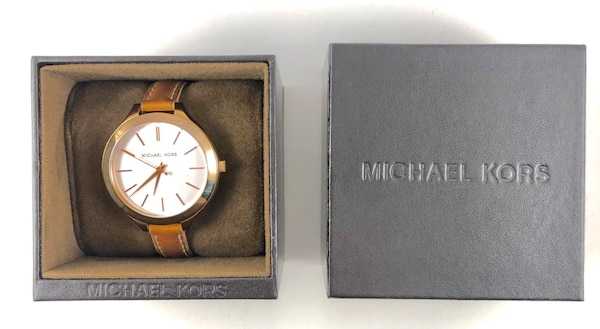 round gold Michael Kors analog watch with brown leather strap 9eacf15e-4682-4012-993d-68b30a681b4b