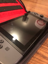 Nintendo Switch w/ Mario Kart, Mario Odyssey and Zelda 30 km