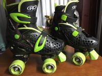 Pair of black-and-green rd roller skates youth size 3