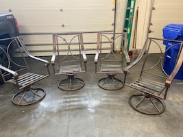 Used - 4 Outdoor Patio Rocking Chairs - No Cushions. $50