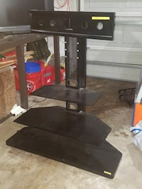 black TV stand with flat screen television