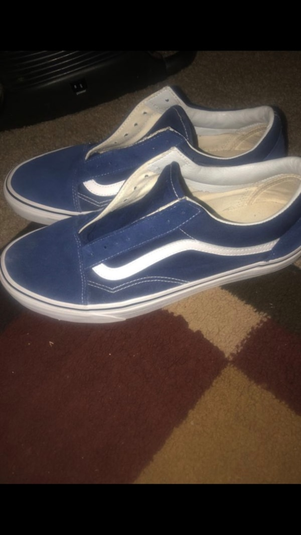 pair of blue-and-white Vans sneakers