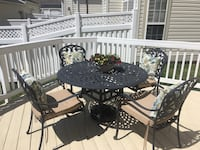 Wrought iron table, 4 chairs, chaise, side table and cushions/pillows Gaithersburg, 20878