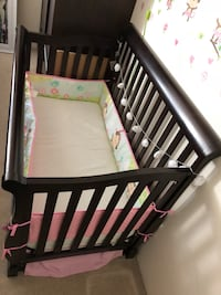 baby's brown wooden crib Richmond, V6X 3W2