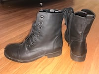 pair of black leather combat boots 30 km