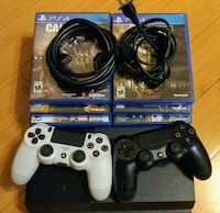 black Sony PS4 console with controllers and game cases Maryland