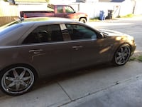 Champagne brown cadillac sedan only 100k basically brand new Calgary, T2B 1W7