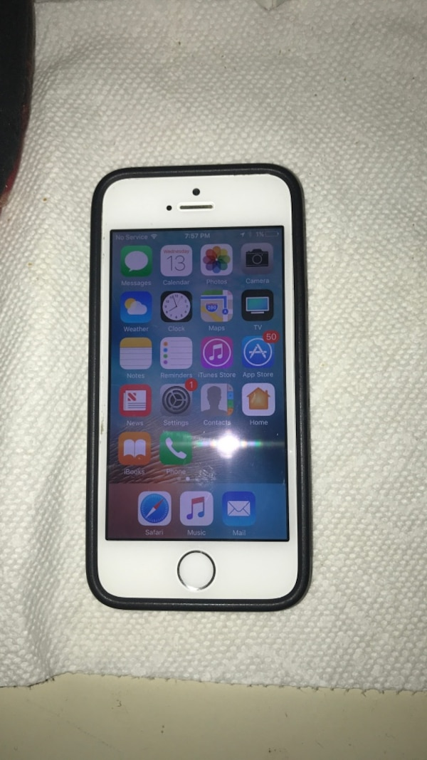 White iphone 5s with black case with chargers