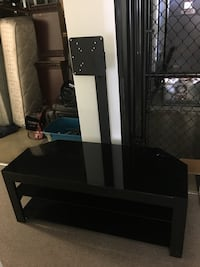 Black glass and metal floating tv entertainment center Gastonia