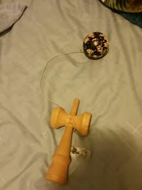 yellow and black kendama toy Dryden, 98821