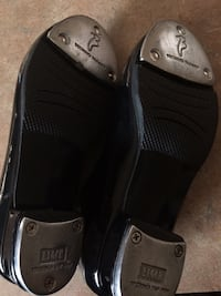 pair of black leather slip-on shoes Spring, 77388