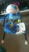 blue and white Fisher price cradle and swing