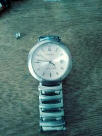 round white and silver-colored Fossil analog watch with silver-colored link band Albuquerque, 87113