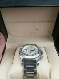 round silver chronograph watch with link bracelet Edmonton, T5N 1P3