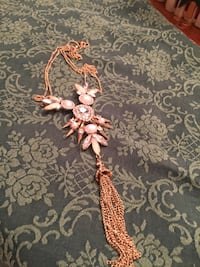 Long gold tassel necklace cream colored stones, pearls and rhinestones