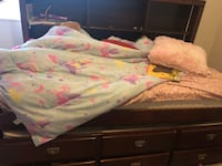 Twin trundle w/ pull out twin bed underneath. Mattresses included