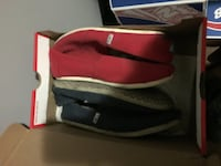 two pairs of red and black slip-on shoes