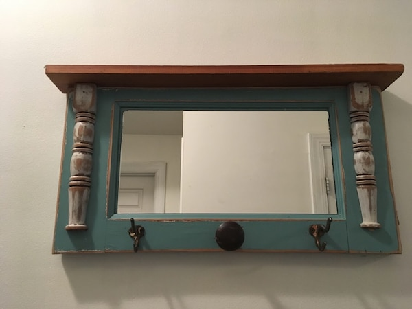 Coat rack with mirror & doorknob detail
