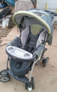 baby's gray and green stroller