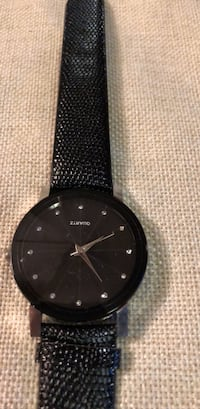Round black analog watch with black leather strap.