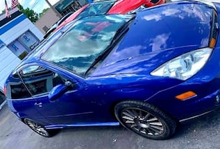 2004 Ford Focus》MANUAL》LEATHER》SUNROOF》GAS SAVER》