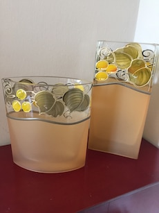 two yellow and green floral glass vases