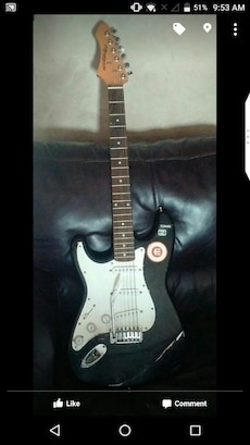 left handed Renegade electric guitar with bag
