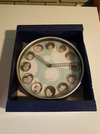 round gray analog wall clock in box 637 km