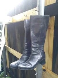 pair of black leather knee-high boots Terrytown, 70056