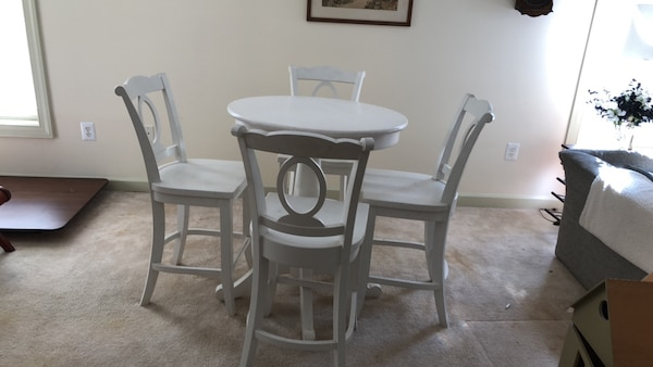 round white wooden table with four chairs dining set