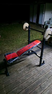 Weight bench with bar and weights will deliver.
