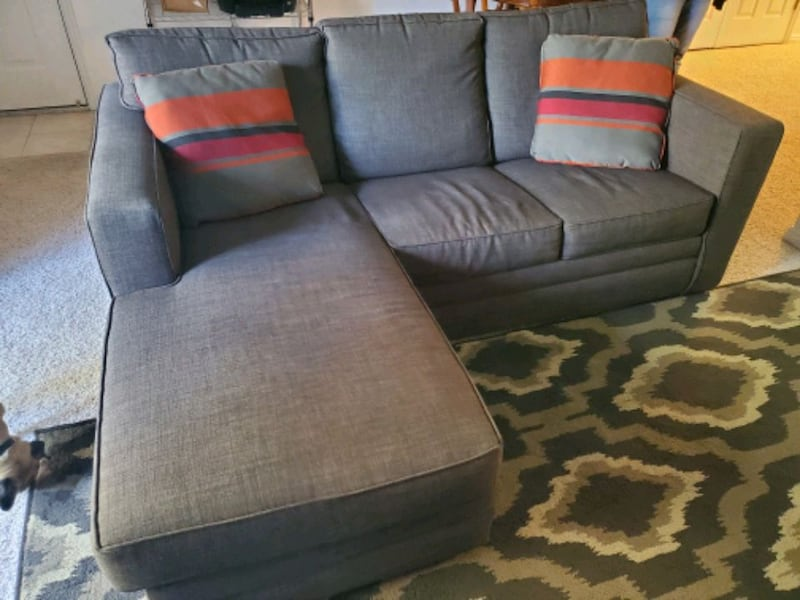 Sofa hide a bed with chaise.  ac3f7912-705b-4248-8f32-466431ae92ac