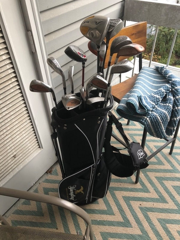 Full set of golf clubs with brand new golf bag!