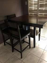 Tall square table with rounded corners come with 7 chairs all together. 3 used 4 brand new.  Toronto, M2R 3N1