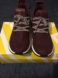 maroon-and-white Adidas low-top sneaker with box