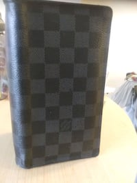 LV wallet retails at 1450$ selling for much less  Richmond, V6Y 3Z8