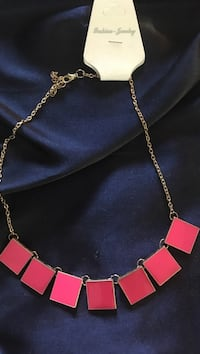 silver-colored red pendant necklace