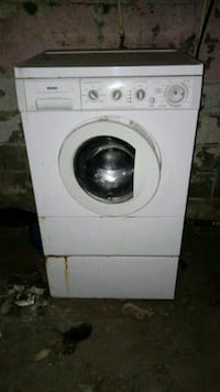 white front-load clothes washer 258 mi